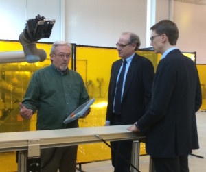 Ron Brown shows Howard Zemsky and Michael Ulbrich how the new Universal UR10 robot works.